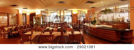 Restaurant interior with served tables panorama