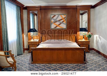 Hotel room showing the kingsize bed, night stands and lamps