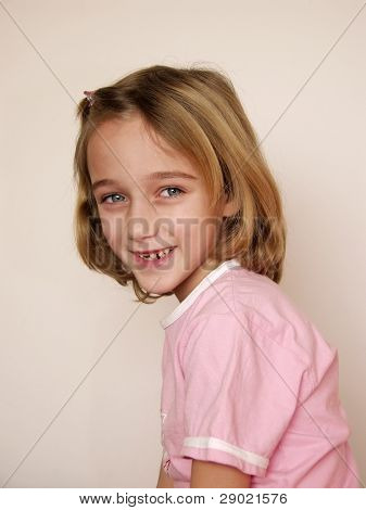 Little girl smiling and showing off her missing tooth