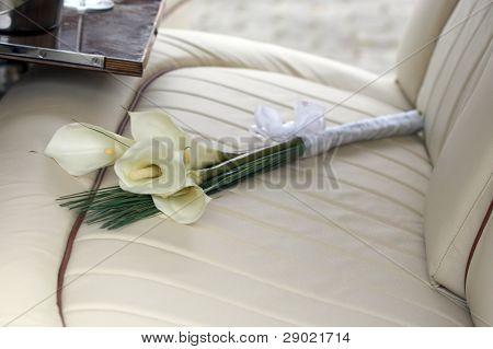 Cala Lily bouquet on the back seat of a limousine
