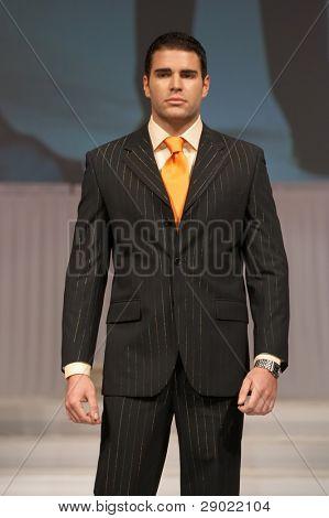 Young man in classic, elegant black suit
