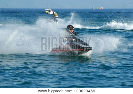 Man speeding on jet ski