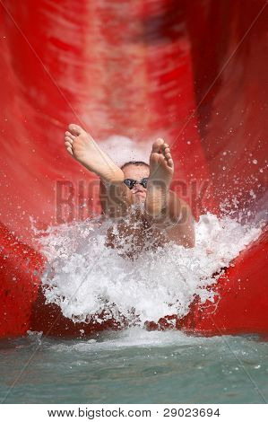 Boy riding down a waterslide