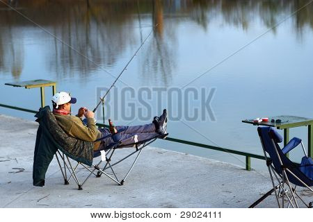Fisherman sitting in his chair and waiting for a catch