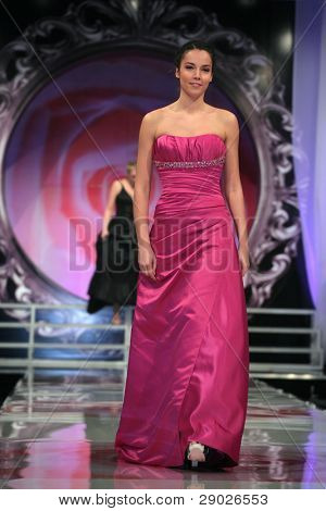 ZAGREB - FEBRUARY 09: Fashion model in evening dress walking down the runway on a 'Wedding Days' show, February 7, 2009 in Zagreb, Croatia.
