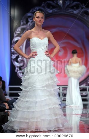 ZAGREB, CROATIA - FEBRUARY 7: Fashion model in wedding dress walking down the runway on 'Wedding days' show, February 7, 2009 in Zagreb, Croatia.