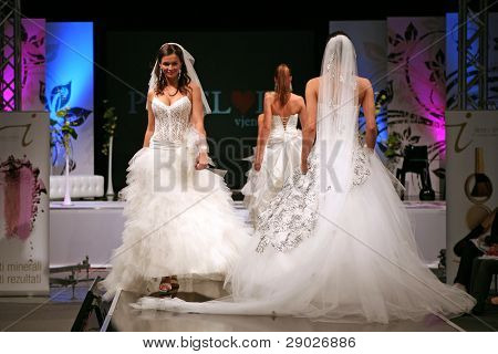 ZAGREB, CROATIA - OCTOBER 3: Fashion models in wedding dress walk down the runway on 'Wedding days' show, October 3, 2009 in Zagreb, Croatia.