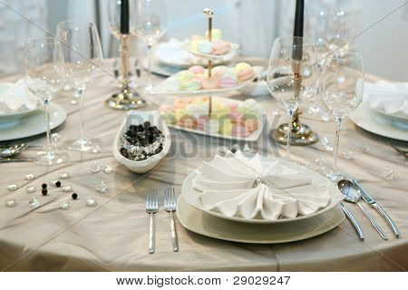 Table setting for elegant wedding dinner
