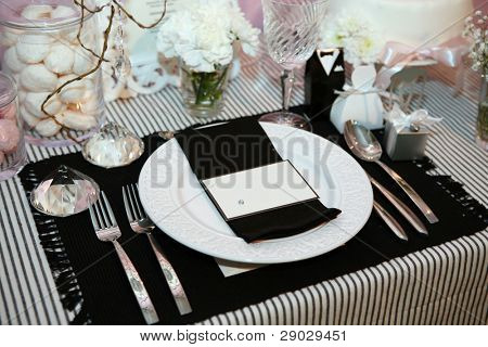 Luxurious dinner in black and white with name tag in the plate