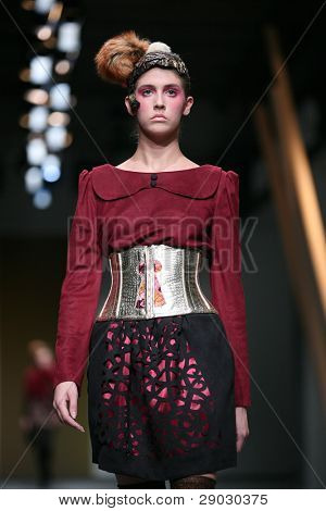 ZAGREB, CROATIA - APRIL 1: Fashion model wears clothes made by Fjaba on 'Croaporter' show, April 1, 2011 in Zagreb, Croatia.
