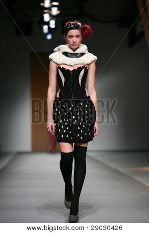 ZAGREB, CROATIA - APRIL 1: Fashion model wears clothes made by Fjaba on 'Croaporter' show, April 1, 2011 in Zagreb, Croatia.
