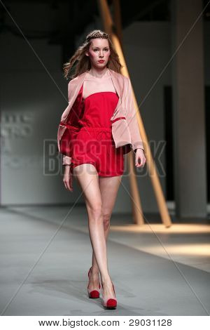 ZAGREB, CROATIA - APRIL 2: Fashion model wears clothes made by Anamarija Asanovic in 'Croaporter' show, April 2, 2011 in Zagreb, Croatia.