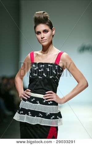 ZAGREB, CROATIA - NOVEMBER 24: Fashion model wears clothes made by Mara Miloglav Moretic on 'Fashion Week Zagreb' show on November 24, 2011 in Zagreb, Croatia.