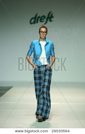 ZAGREB, CROATIA - NOVEMBER 24: Fashion model wears clothes made by Aba Tomicic on 'Fashion Week Zagreb' show on November 24, 2011 in Zagreb, Croatia.