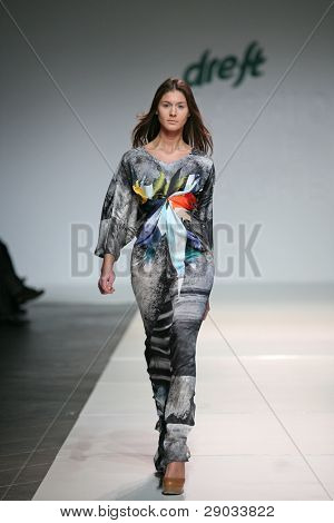ZAGREB, CROATIA - NOVEMBER 25: Fashion model wears clothes made by Basso and Brooke on 'Fashion Week Zagreb' show on November 25, 2011 in Zagreb, Croatia.