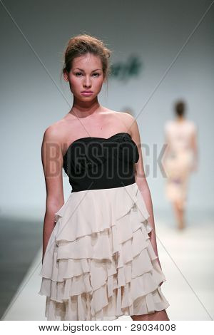 ZAGREB, CROATIA - NOVEMBER 25: Fashion model wears clothes made by S. Oliver on 'Fashion Week Zagreb' show on November 25, 2011 in Zagreb, Croatia.