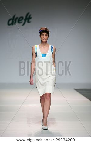 ZAGREB, CROATIA - NOVEMBER 25: Fashion model wears clothes made by Nino Bollag on 'Fashion Week Zagreb' show on November 25, 2011 in Zagreb, Croatia.