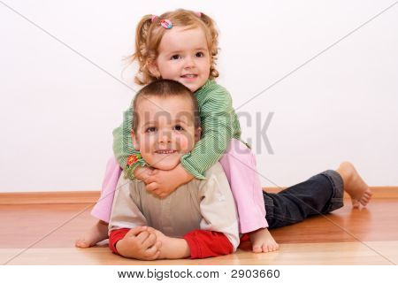 Happy Kids Playing On The Floor