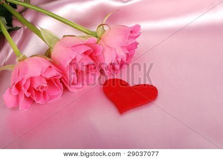 shape of a heart with pink roses