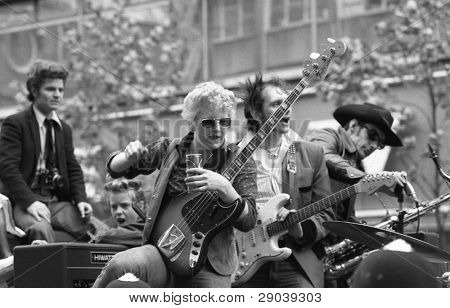 """LONDON - MAY 15: Rockabilly band """"The Flying Saucers"""" play during the Rock 'n' Roll Radio Campaign march on May 15, 1976 in London, England. The campaign wants more Rock 'n' Roll music on British radio."""