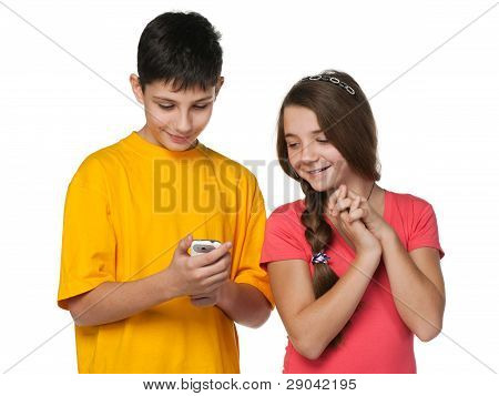 Happy Teenagers  With A Cell Phone