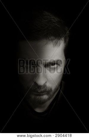 Low-Key Portrait Of An Ominous Man