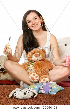 Smiling Girl Blow Bubbles. Isolated