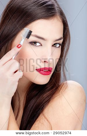 Woman Combing Eyebrow