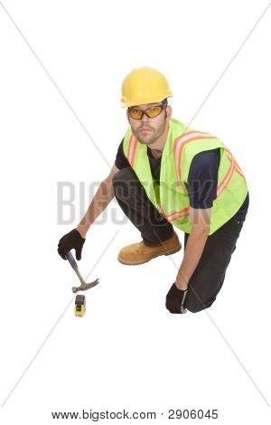 Construction Worker Kneeling With Hammer