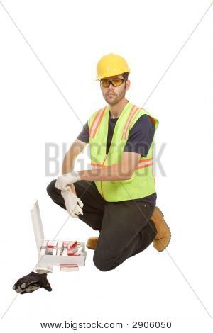 Construction Worker Kneeling With First Aid Kit