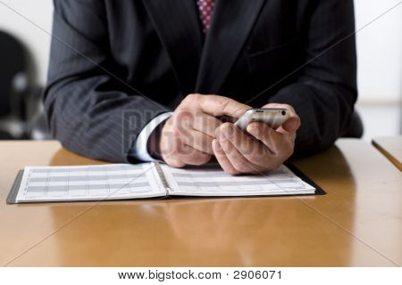 Businessman Checking His Schedule On Cell Phone.