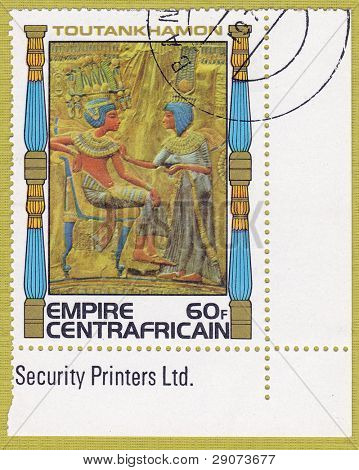 CENTRAFRICAIN - CIRCA 1978: A stamp printed in The Central African Empire showing the image of a throne decoration, series is devoted to Egyptian Pharaoh Tutankhamun, circa 1978