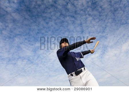 young baseball player taking a swing strike