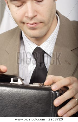 Man Trying To Unlock Briefcase - Closeup
