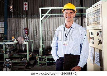 happy male technician in factory