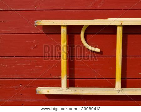 Wooden Ladder Hanged On A Wall