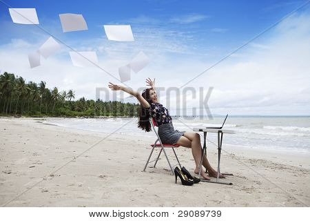 Happy Businesswoman With Working Papers
