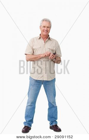 Smiling mature male with his cellphone against a white background