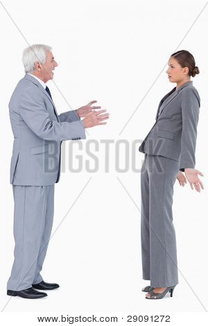 Businessman accusing colleague against a white background