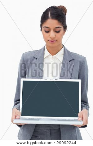 Businesswoman looking at notebook in her hands against a white background