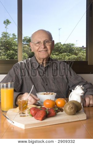Senior Man Having A Healthy Breakfast