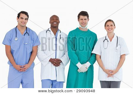 Smiling medical team standing together against a white background