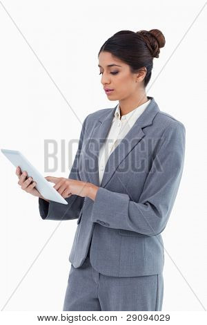 Saleswoman using tablet computer against a white background
