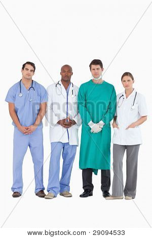 Confident medical team standing together against a white background