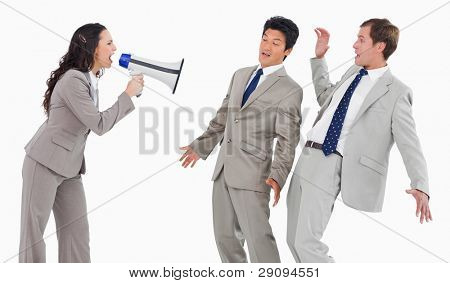 Businesswoman with megaphone shouting at colleagues against a white background