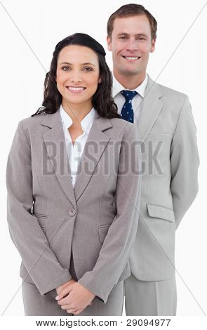Smiling office staff standing together against a white background