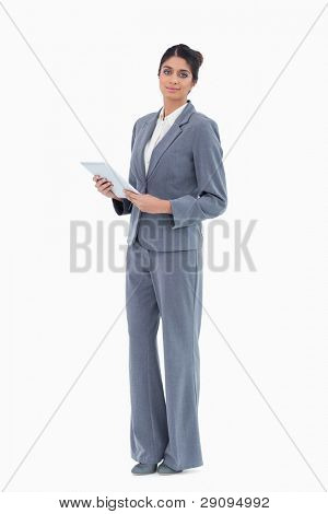 Saleswoman with tablet computer against a white background