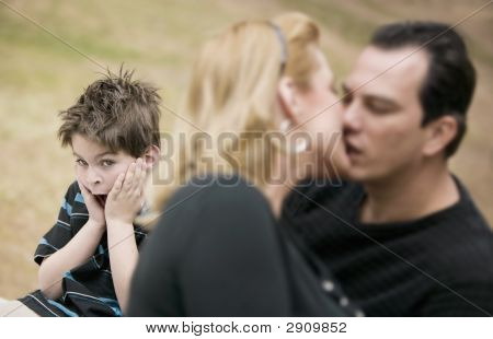 Kissing Adults And Horrified Boy
