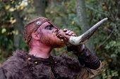 Real viking Real viking drinking from a horn in the countryside. He is coming the war poster