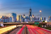 Chicago, Illinois, USA downtown skyline over highways at twilight.  poster